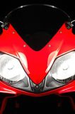 Red Honda CBR. The red front fairing and headlights of a Honda motorcycle stock photo