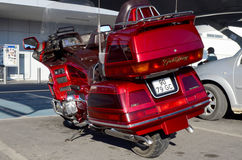 Red Honda Goldwing. Back end and side view of a old Honda Goldwing motorbike royalty free stock photography