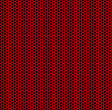 Red honeycomb. Red abstract pattern of metal in the form of honeycomb Royalty Free Stock Image