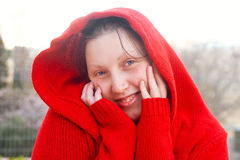 Red-hooded girl Stock Photos