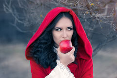 Red Hooded Woman Holding Apple Fairytale Portrait Stock Images