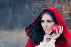 Red Hooded Woman Holding Apple Fairytale Portrait Stock Photography