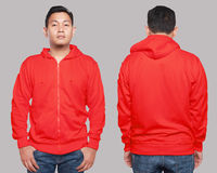 Red Hoodie Mock up. Blank sweatshirt mock up, front, and back view, isolated on grey. Asian male model wear plain red hoodie mockup. Hoody design presentation Royalty Free Stock Photo