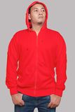 Red Hoodie Mock up. Blank sweatshirt mock up, front view, isolated on grey. Asian male model wear plain red hoodie mockup. Hoody design presentation. Jumper for Stock Image