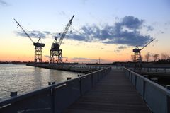 Red Hook Boardwalk and Cranes Royalty Free Stock Photography