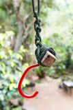 Red hook tied with nylon rope. Stock Photography
