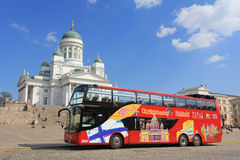 Red Hop On Hop Off Sightseeing Bus and Helsinki Cathedral Royalty Free Stock Image