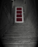 Red Hope. Steps leading up to a red closed door Royalty Free Stock Photos