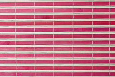 A red horizontal bamboo mat. Royalty Free Stock Photo