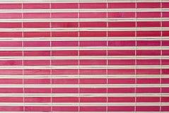 A red horizontal bamboo mat. Royalty Free Stock Photo