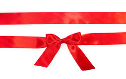 Red horizontal gift ribbons and luxurious bow royalty free stock photo