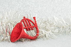 Red horn and a christmas wreath Royalty Free Stock Images