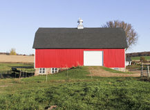 Red horse barn Stock Images