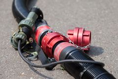 Red hose coupling. For water lies on ground stock photos