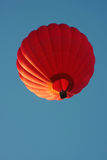 Red hot air balloon. Against blue sky Stock Photography