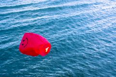 Red Hot air balloon. An image of red hot air balloon over the sea Royalty Free Stock Photo