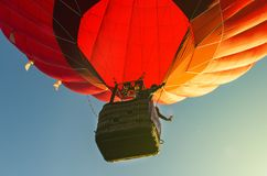 Red hot air balloon against the blue sky.  royalty free stock images