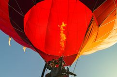 Red hot air balloon against the blue sky.  stock image