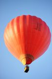 Red hot air balloon. On blue background Stock Photography