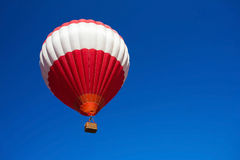 Red hot air balloon on blue sky. Adventure or race concept Stock Photos