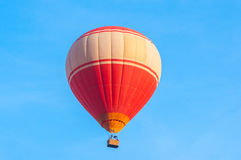 Red hot air balloon. On blue sky Stock Photography