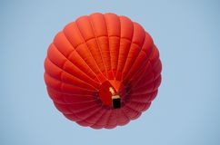 Red hot air balloon in a clear blue sky. stock photos
