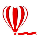 Red hot air balloon in the shape of a heart cutout with blank fl Royalty Free Stock Photo