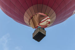 Red hot air balloon. In the sky closeup Royalty Free Stock Photo