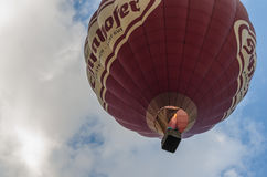 Red hot air balloon on the sky. Red hot air balloon floating in the sky Royalty Free Stock Image