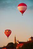 Red hot air balloons in blue sky with white clouds Royalty Free Stock Photo