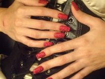 Red Hot Bedazzled Nails Stock Image