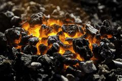 Red hot carbon in a coals for cooking. Detail of heat and fire royalty free stock image