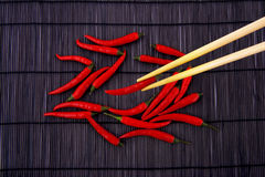 Red hot chili. Pepper on chinese mat Stock Image