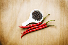 Red hot chili black pepper on wood table Royalty Free Stock Photo