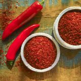 Red hot chili Cayenne pepper fresh and dried powdered spice, rea. Dy to use on wooden background Stock Photography