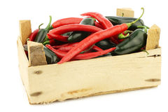 Red hot chili and green peppers jalapeno in a wooden box Royalty Free Stock Photo