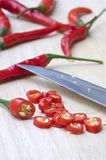 Red hot chili pepper. On a chopping block Stock Photography