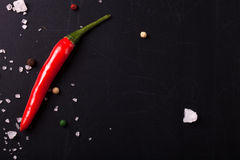 Red hot chili Pepper, coarse salt on the chalkboard with place Royalty Free Stock Photography