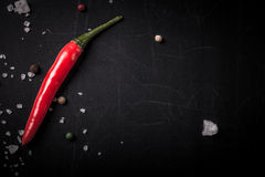 Red hot chili Pepper, coarse salt on the chalkboard with place Royalty Free Stock Photos