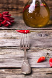 Red hot chili pepper on fork Stock Images