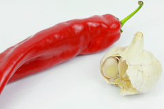 Red hot chili pepper with garlic. Red hot chili pepper on whithe background Stock Images