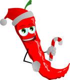 Red hot chili pepper holding a candy cane and wearing Santa's hat Royalty Free Stock Photos