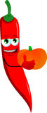 Red hot chili pepper holding pumpkin Royalty Free Stock Photos
