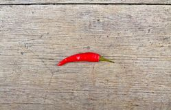Red hot chili pepper on wooden table Royalty Free Stock Photography