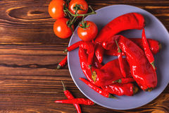 Red hot chili pepper pickled with tomatoes in plate Stock Photography