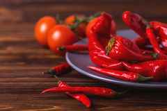 Red hot chili pepper pickled with tomatoes in plate Royalty Free Stock Image