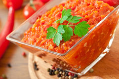 Red hot chili pepper and sauce on glass bowl Royalty Free Stock Photo
