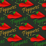 Red hot chili pepper seamless pattern on dark background.  Royalty Free Stock Photo