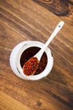 Red hot chili pepper on the spoon Stock Photo
