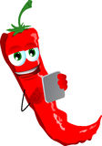 Red hot chili pepper using a tablet Royalty Free Stock Photography